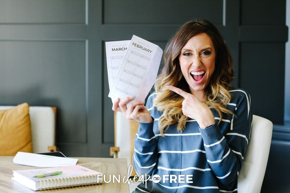 Jordan Page holding budget envelopes, from Fun Cheap or Free