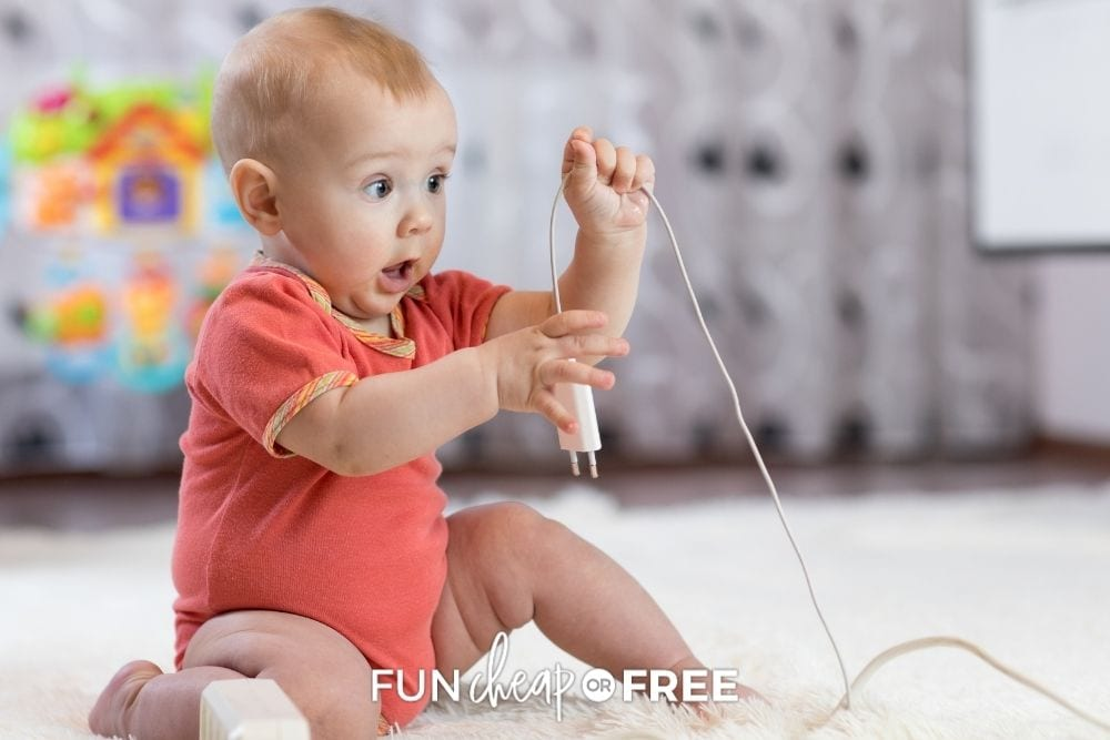 baby playing with cords that weren't baby proofed, from Fun Cheap or Free