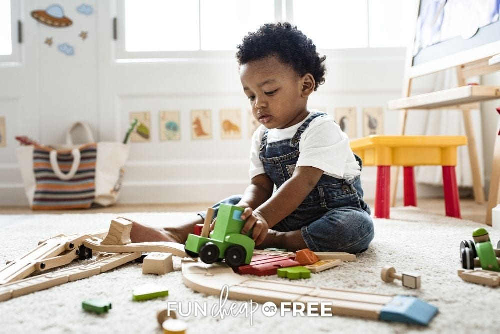 young toddler playing with toys in his room, from Fun Cheap or Free