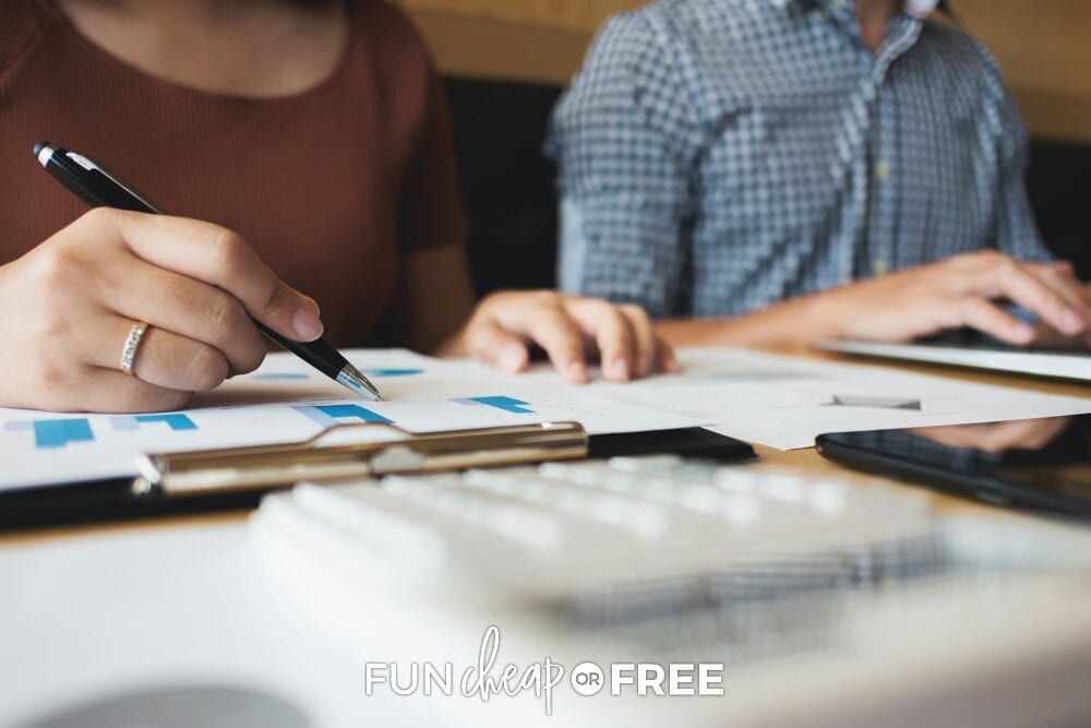 Couple looking at finances, from Fun Cheap or Free