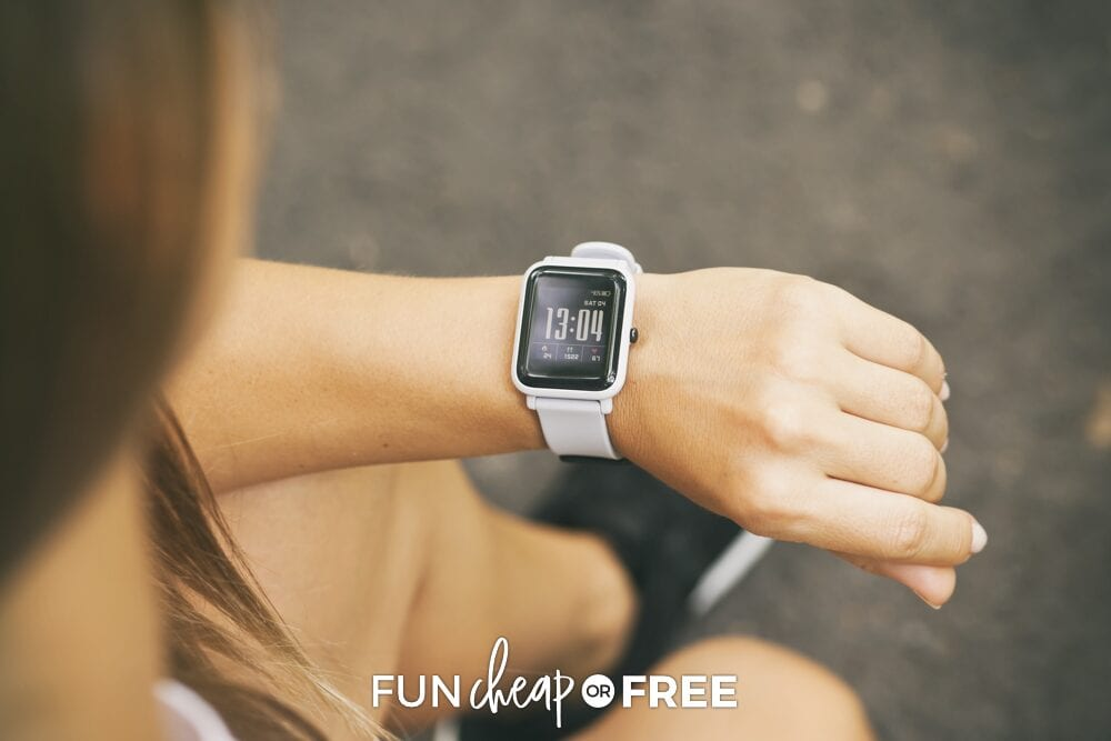 woman looking at smart watch, from Fun Cheap or Free