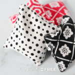 four handmade hand warmers red, white, and black patterned from Fun Cheap or Free