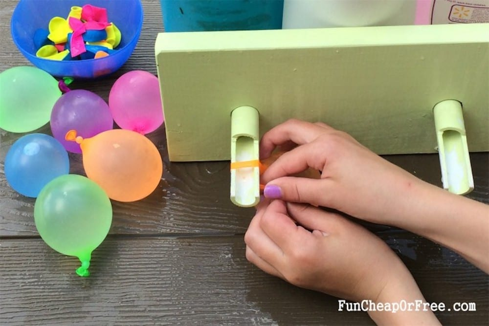 girl tying water balloons, from Fun Cheap or Free