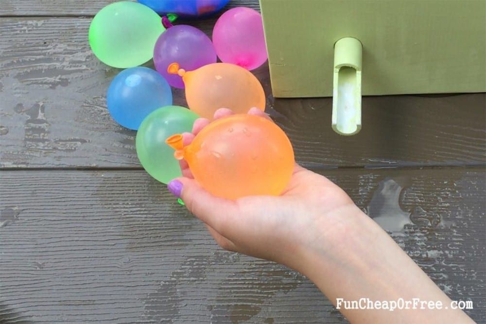 girl holding water balloon, from Fun Cheap or Free