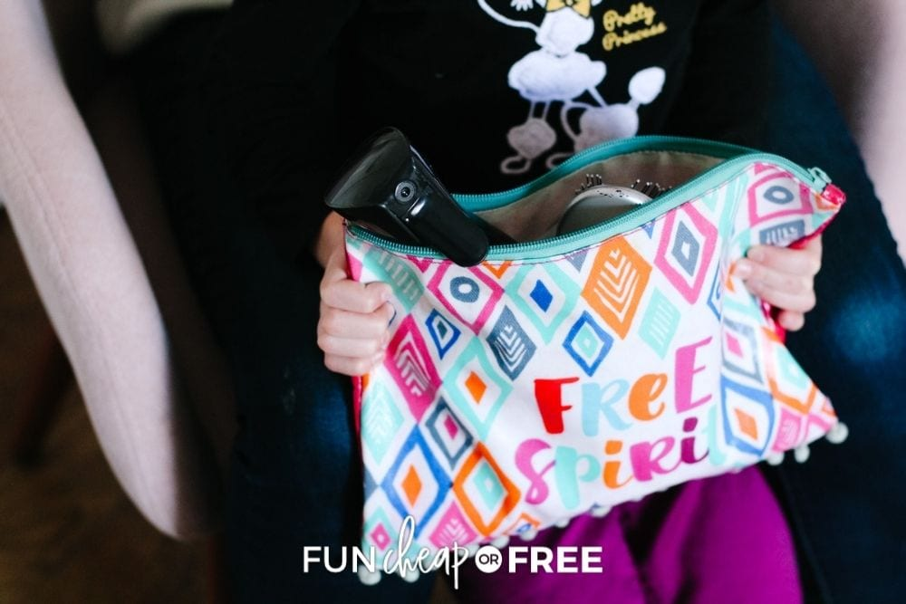 girl holding bag full of hair accessories, from Fun Cheap or Free