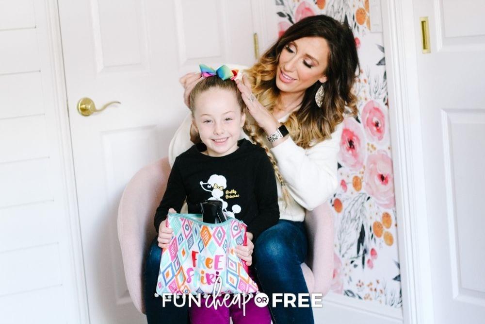 Jordan Page brushing daughter's hair with hair bag, from Fun Cheap or Free