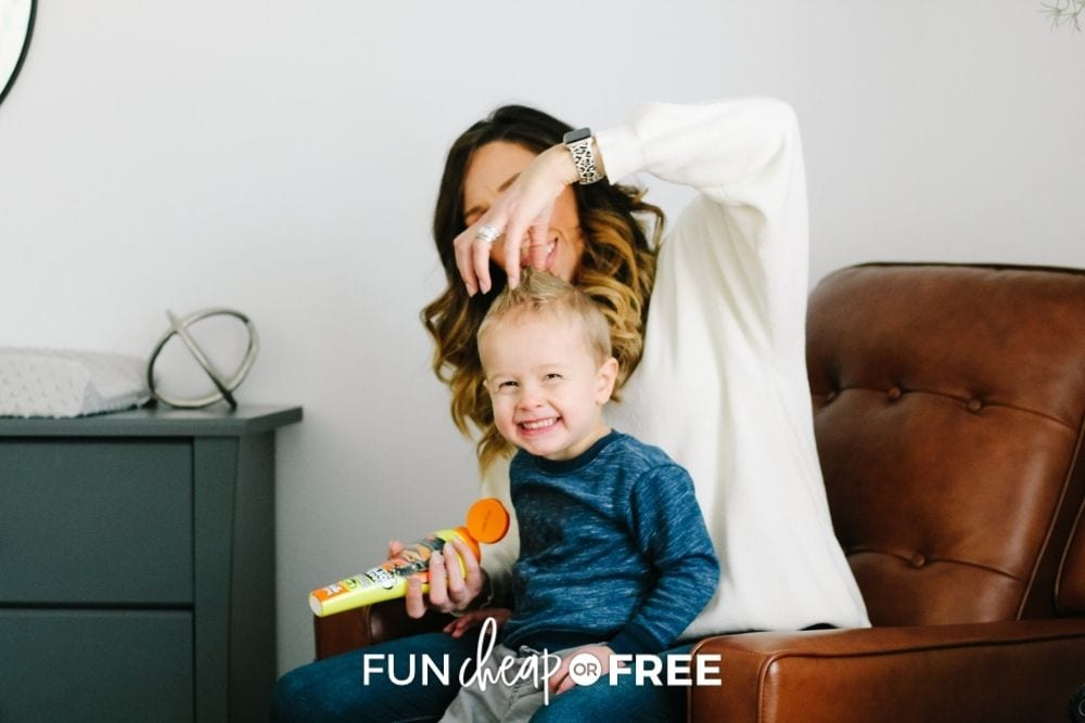 Jordan Page putting gel in son's hair, from Fun Cheap or Free