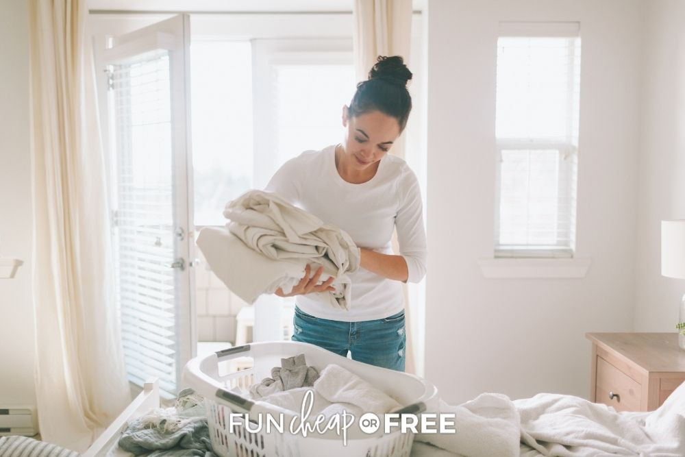 woman completing simple task of folding towels, from Fun Cheap or Free