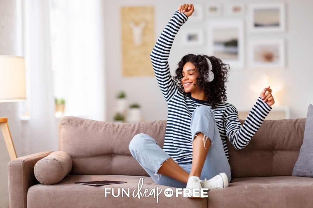 woman doing happy dance on couch, from Fun Cheap or Free