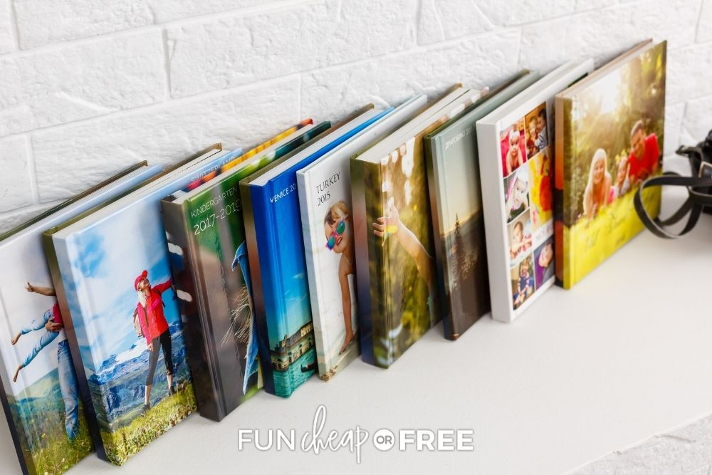 stack of family photo books on mantle, from Fun Cheap or Free