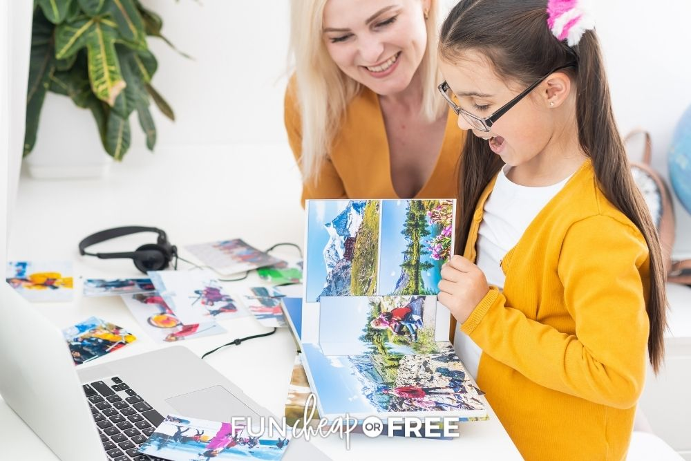 mom and daughter looking at photo book, from Fun Cheap or Free