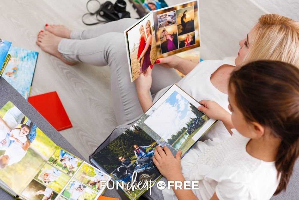 mom and daughter looking at photo books, from Fun Cheap or Free