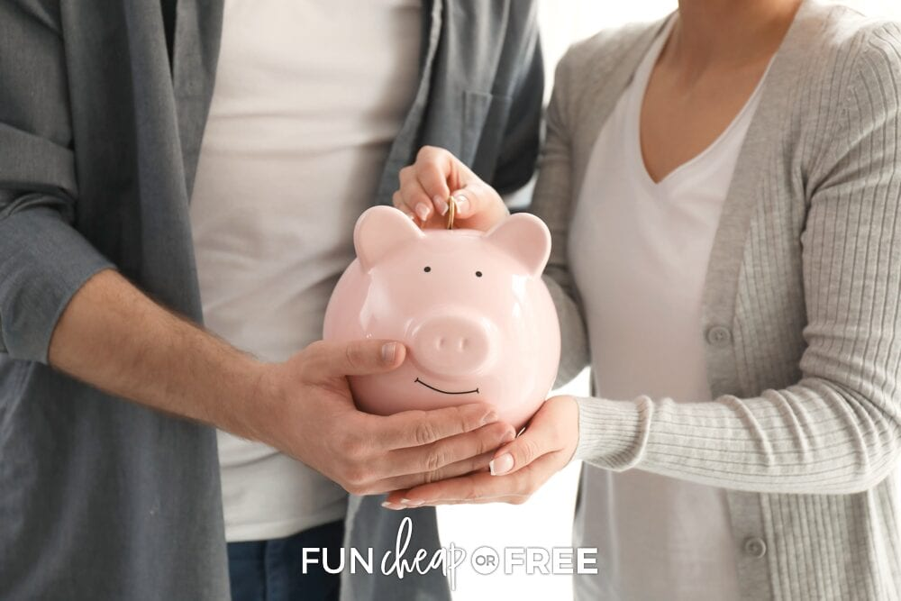 Couple putting money into piggy bank, from Fun Cheap or Free