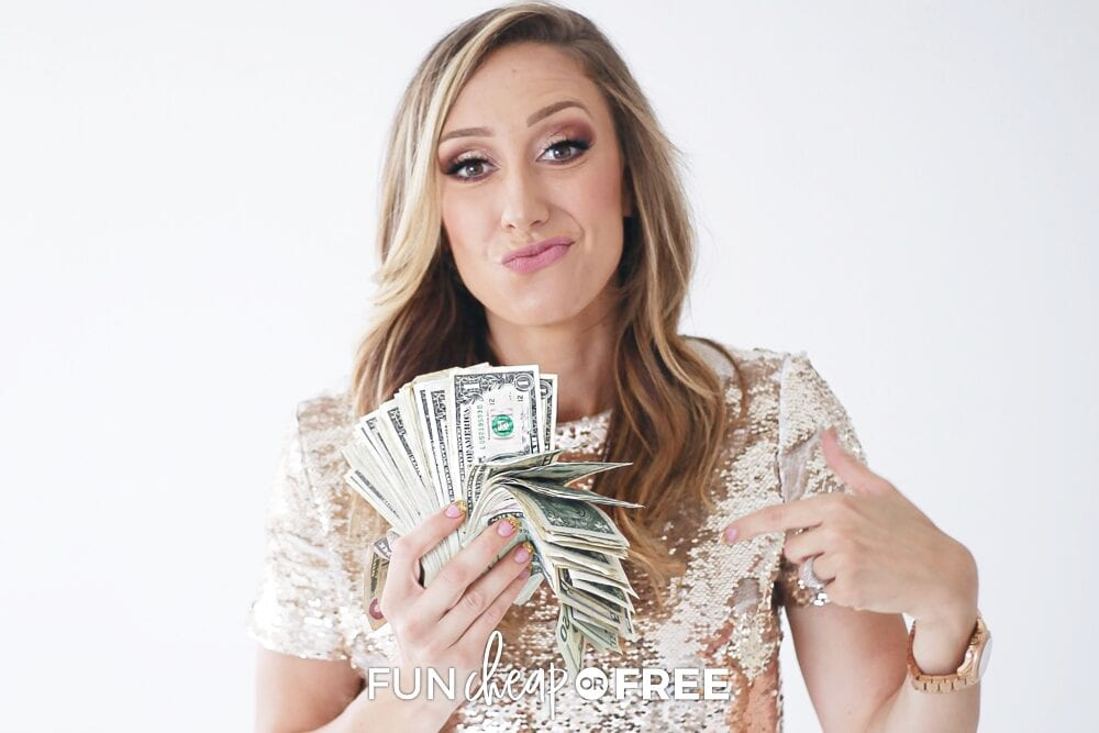 Jordan pointing at money in her hand, from Fun Cheap or Free