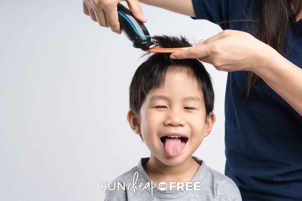 mom cutting boy's hair at home