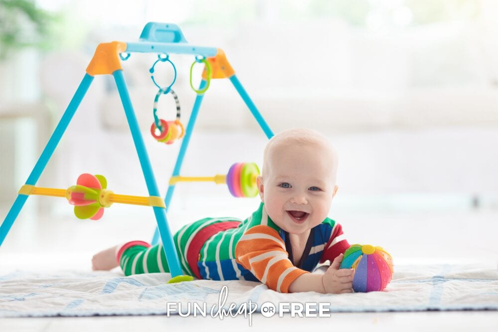 Baby holding clean toy on the floor, from Fun Cheap or Free