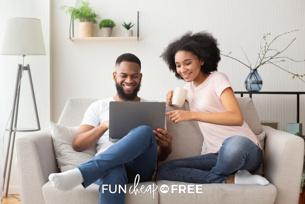 couple booking flights on laptop, from Fun Cheap or Free