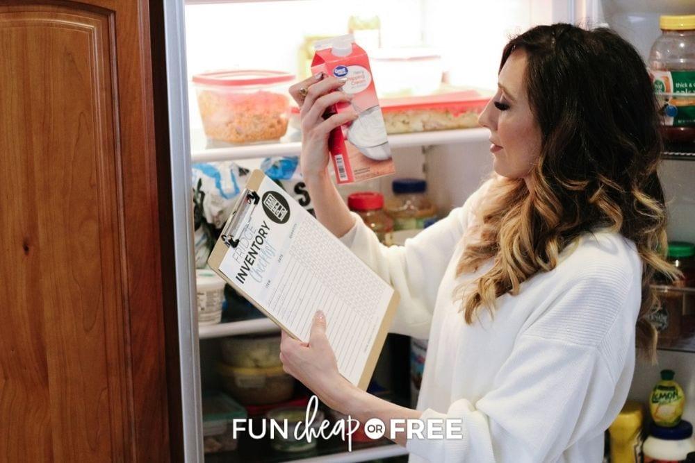 Jordan Page examining ingredients in fridge, from Fun Cheap or Free