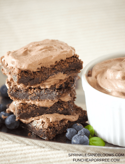World's best brownie recipe, easy to make, just a few ingredients, with whipped cream frosting. They are chocolatey, chewy, thick, and frosted. The best dessert for your next party! www.FunCheapOrFree.com