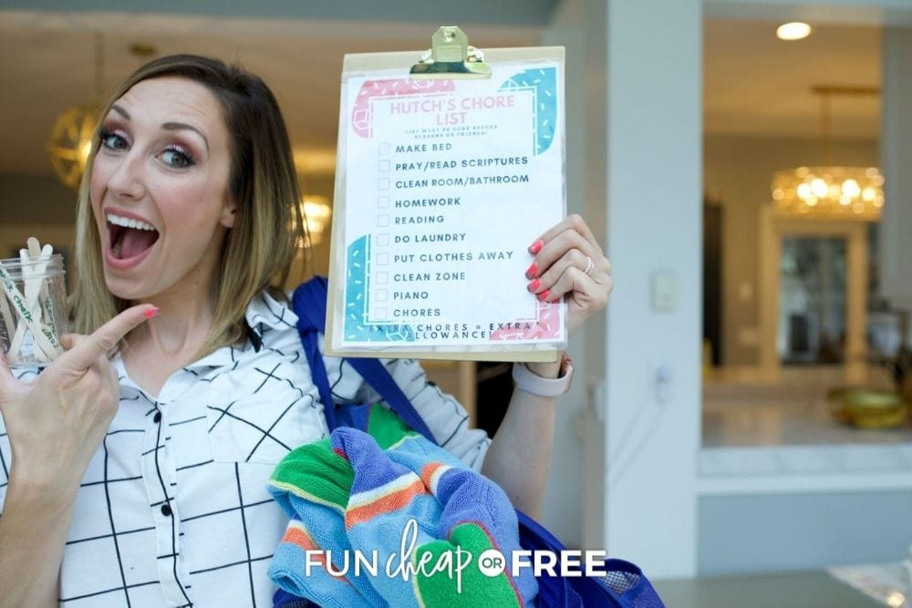 Jordan Page holding chore sticks and chart, from Fun Cheap or Free