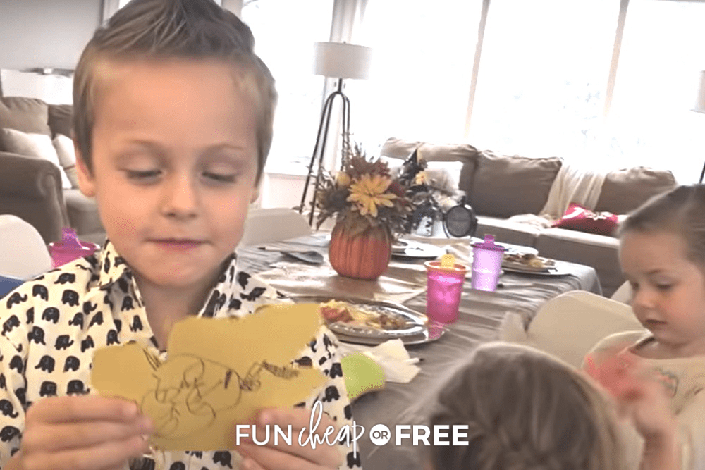 young boy holding a leaf for a gratitude tree, from Fun Cheap or Free