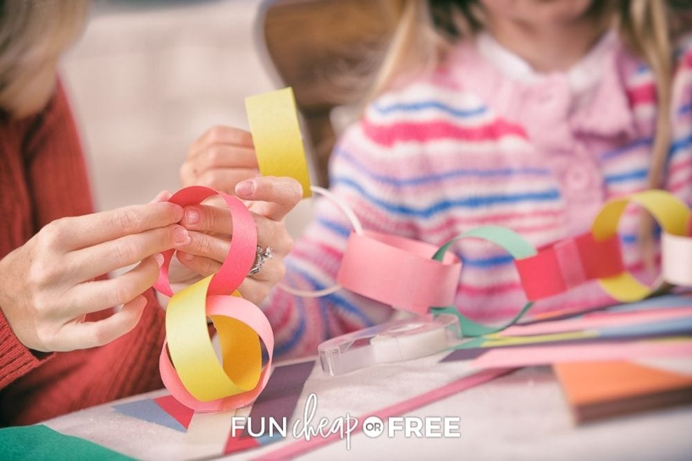kids making paper chains for Father's Day, from Fun Cheap or Free