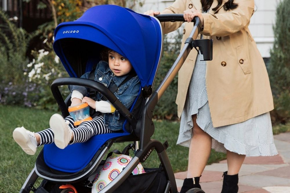 mom pushing baby in Colugo stroller, from Fun Cheap or Free