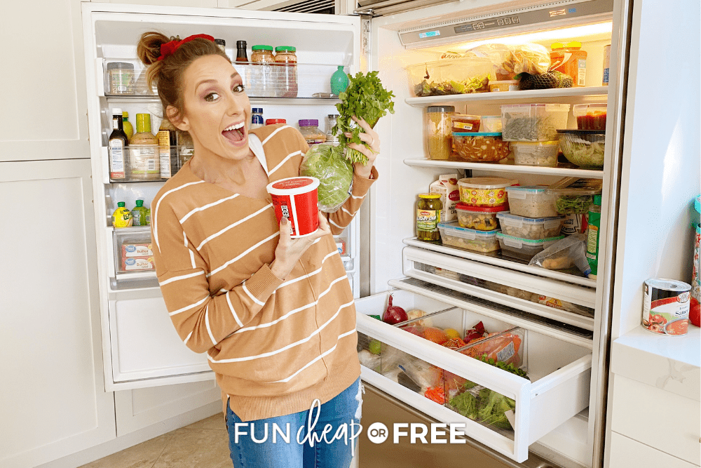 Jordan holding produce and dairy in front of her open refrigerator, from Fun Cheap or Free