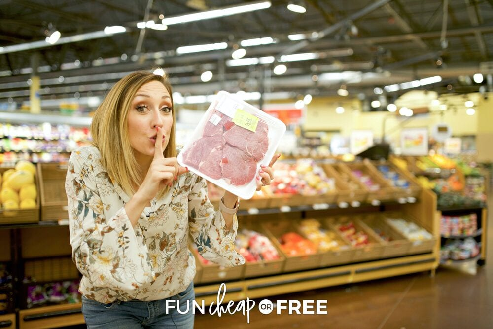 Jordan holding a pack of meat, from Fun Cheap or Free