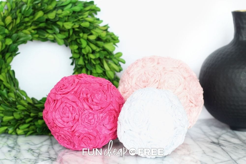 homemade pink and white tissue paper pomander balls, from Fun Cheap or Free