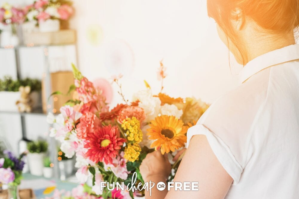 Woman putting together a floral arrangement, from Fun Cheap or Free