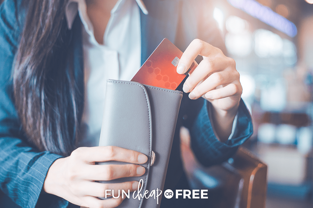 woman putting a credit card back into her wallet, from Fun Cheap or Free