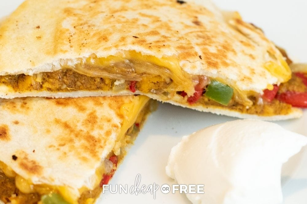 black bean quesadilla on plate with sour cream, from Fun Cheap or Free