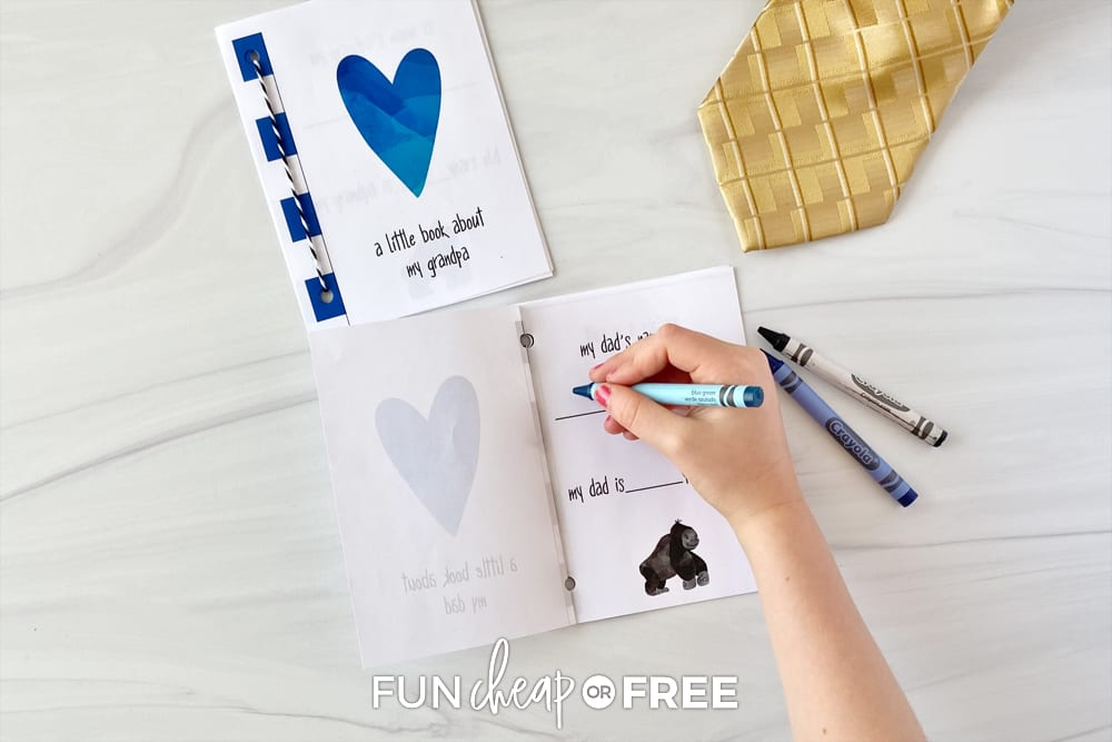 Child writing in Father's Day printable interview book, from Fun Cheap or Free