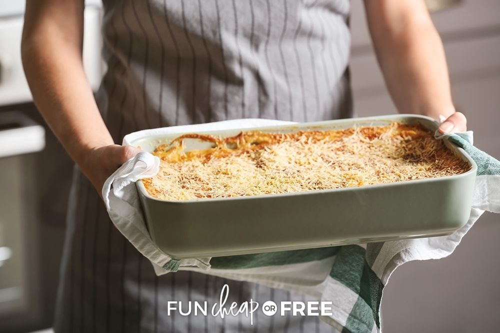 woman taking freezer meal out of oven, from Fun Cheap or Free