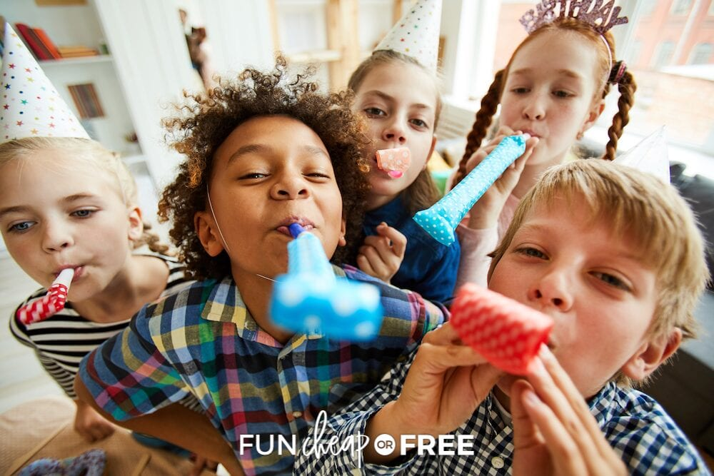 Kids blowing birthday party blowers into the camera, from Fun Cheap or Free