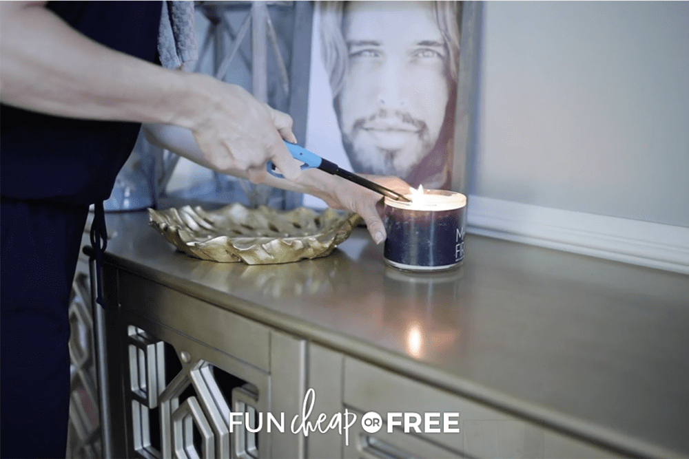 woman lighting a candle, from Fun Cheap or Free