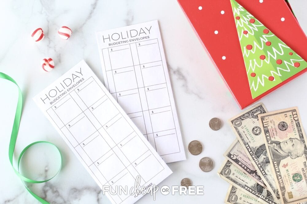Holiday shopping budget envelopes on a counter, from Fun Cheap or Free