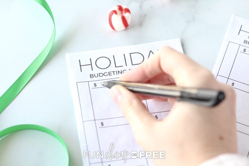 Hand writing on holiday budget tracker from Fun Cheap or Free