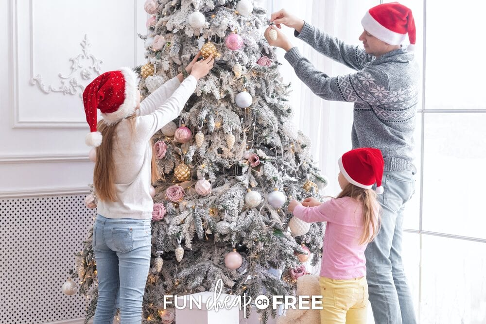 Family decorating Christmas tree, from Fun Cheap or Free