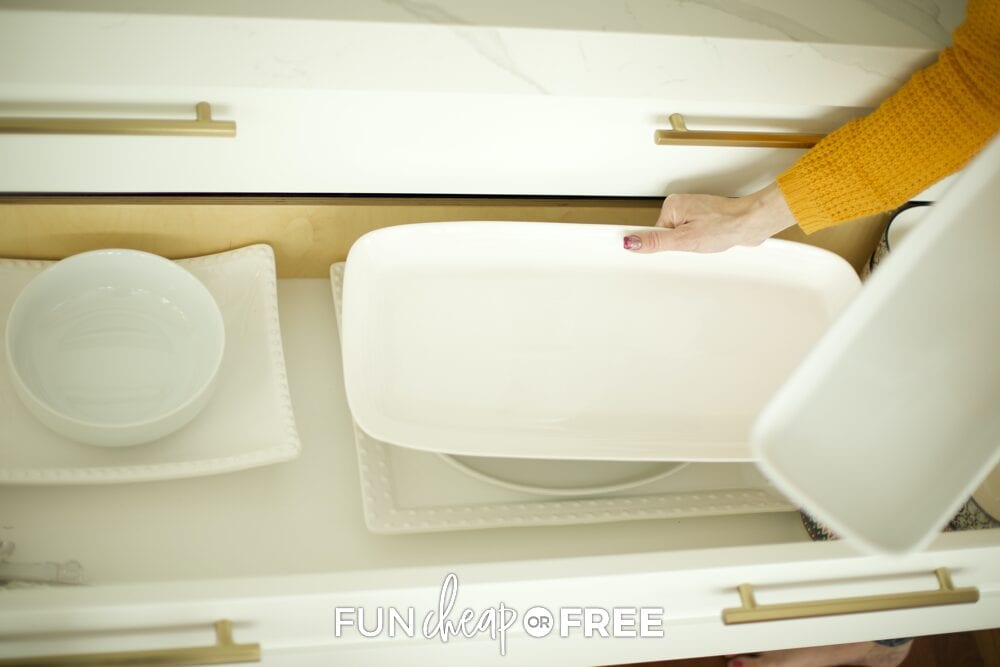 Jordan grabbing serving platters from a drawer, from Fun Cheap or Free