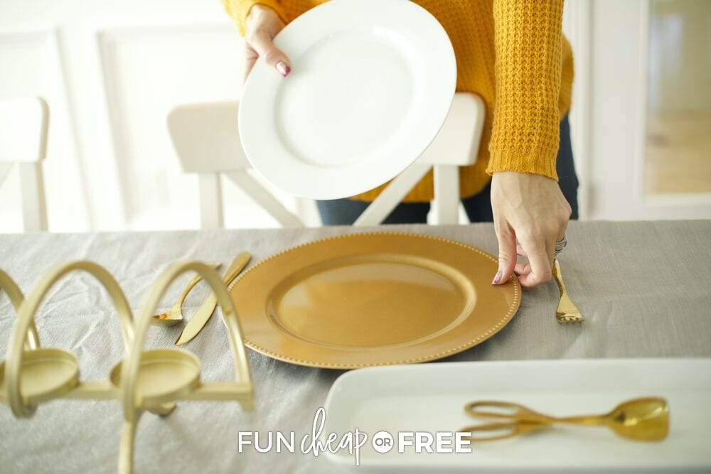 Jordan putting charger and plate on a table, from Fun Cheap or Free