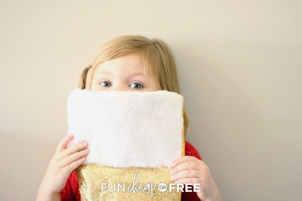 Little girl holding Christmas stocking, from Fun Cheap or Free
