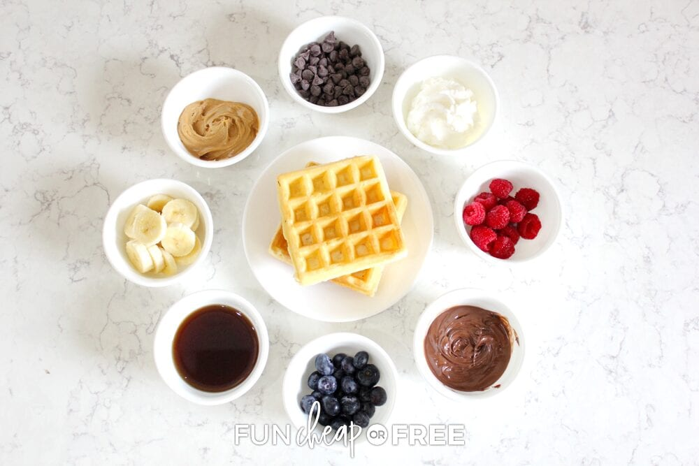 Waffles and toppings on a counter, from Fun Cheap or Free