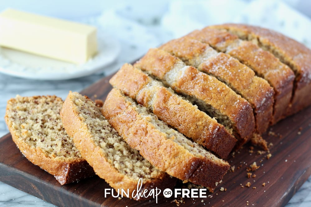 Banana bread recipe sliced up on a wooden platter, from Fun Cheap or Free