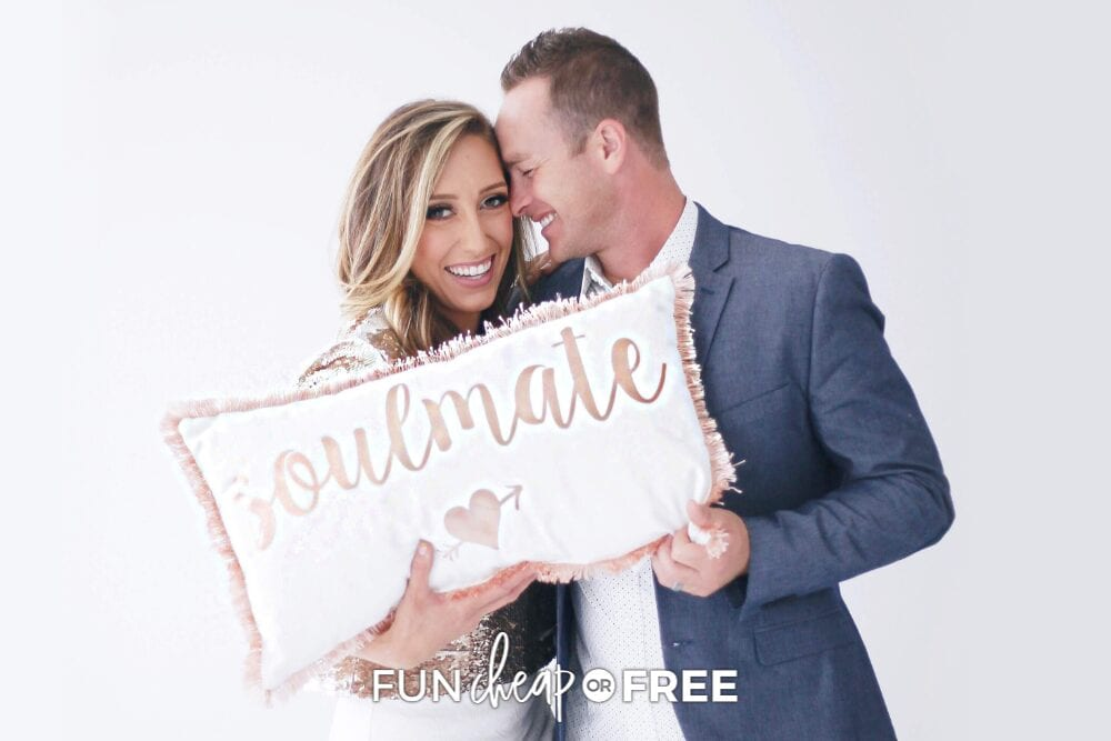 Jordan and Bubba holding a pillow that says soulmate, from Fun Cheap or Free