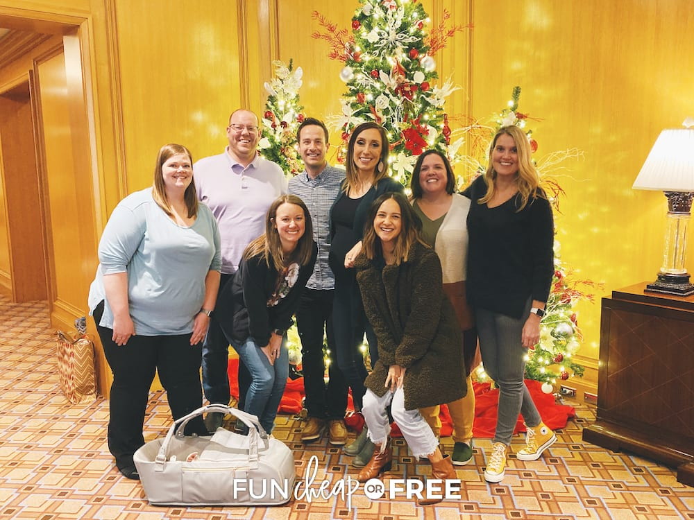 The Fun Cheap or Free Team in front of a Christmas tree