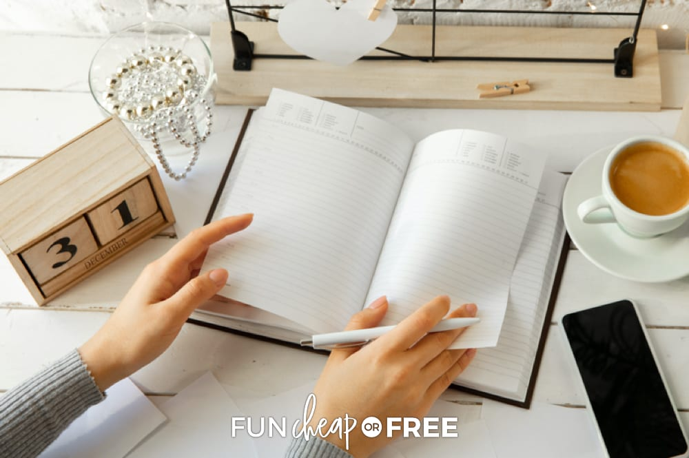Hands turning planner pages, from Fun Cheap or Free