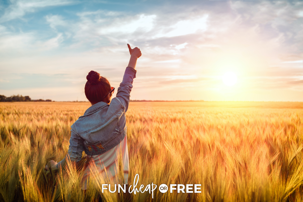 Woman holding her thumb up in a field, from Fun Cheap or Free