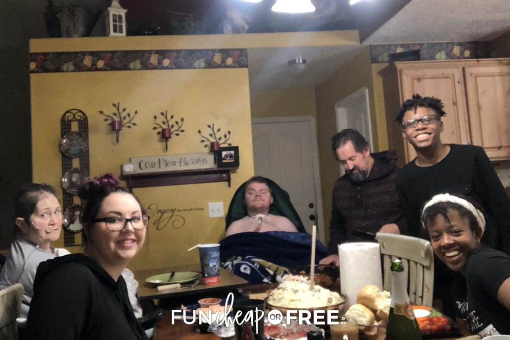 The Sorensen family sitting at a table, from Fun Cheap or Free